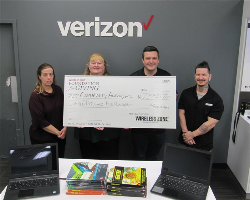 Showing some of the new laptops and textbooks purchased for the Adult Education Project at Community Action, Inc. by a grant from The Wireless Zone Foundation for Giving are: (l-r) Community Action, Inc.