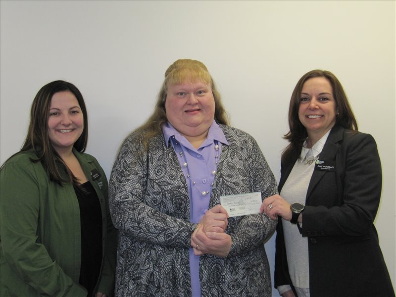 Employees of Farmers National Bank of Emlenton (FNB), Punxsutawney Branch recently selected the Adult Education Project of Community Action, Inc. (CAI) to receive proceeds from their Community Jeans Day Program. Presenting the check to (center; right) Susan K. Fusco, Executive Director of CAI is Amy Wundrack, Punxsutawney Branch Manager with Kelsey Huey, Senior Personal Banker looking on (left).